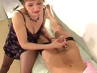 MILF in Pantyhose Gives Her Doctor a Handjob