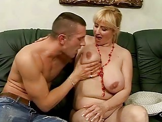 Lusty busty granny fucking with young man