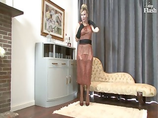 Blonde MILF strips and uses her sexy high heels