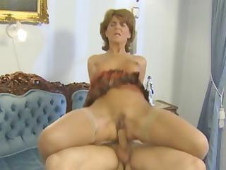 Busty blonde mature enjoys a hard cock she sucks