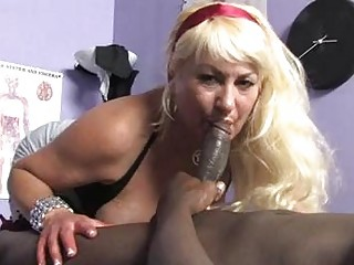 Sporty blonde momma with large melons sucks dark