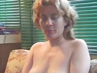 Mature blonde plays with herself before taking on