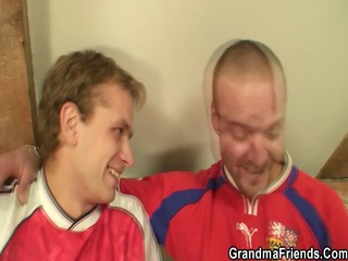 Two football fans bang old bitch