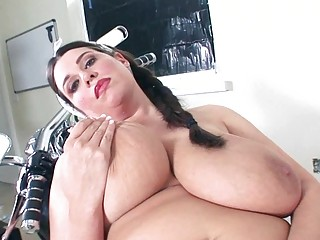 Horny MILF babe shows off her mega sized juggs