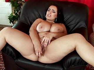 Sinful brunette MILF lady masturbates in black