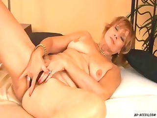 Mature redhead gets naked and blows before he
