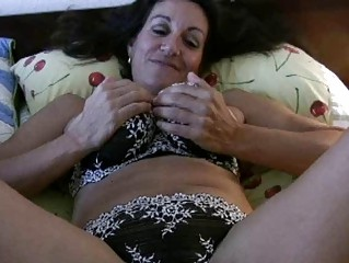 Dark haired busty milf in sexy lingerie rides