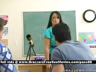 Busty brunette teacher at school going through an