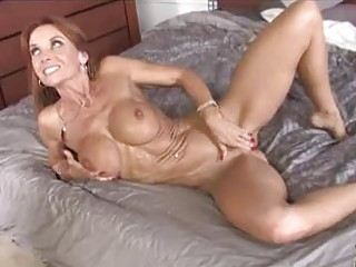 Skinny brunette milf with big tits gets covered