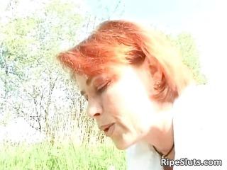 Big boobed mature redhead gets wet cunt