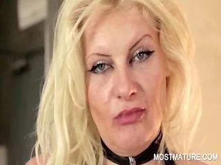 Mature in latex working big tits