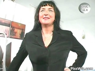 Busty mature shows her massive tits