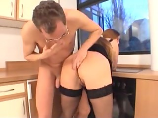 Perverted busty MILF fucked in the kitchen