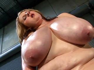 Mega breasted MILF lady oils her fat rack