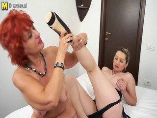 Hot girl and a redhead mature mom having great