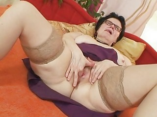 Old grandma with glasses fingering hairy pussy