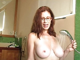 Naughty redhead milf with glasses gets cum on her