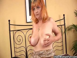 Redheaded granny with large titties sucks strapon
