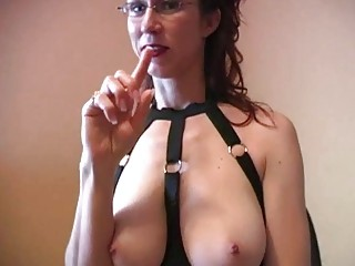 Kinky redhead milf with glasses does titjob with