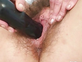 Redhead mature lady gets her hairy twat examined