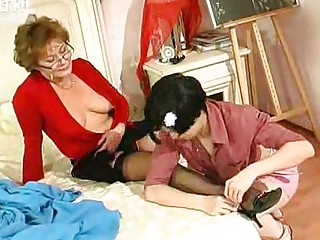 Young girl kisses and licks mature woman