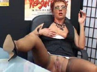 Sexy Mature Secretary smokes and fingers pussy