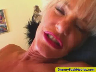 Blonde mature playing with a small toy