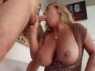 Heavy chested tanned blonde momma sucks stiff knob