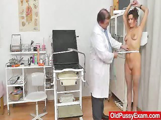 Redhead mature spreads her legs at fetish clinic
