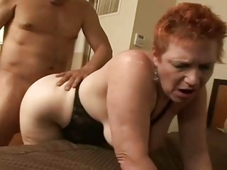 Redhead granny getting her cunt pounded on a couch