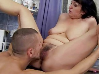 Busty granny gets fucked in the kitchen